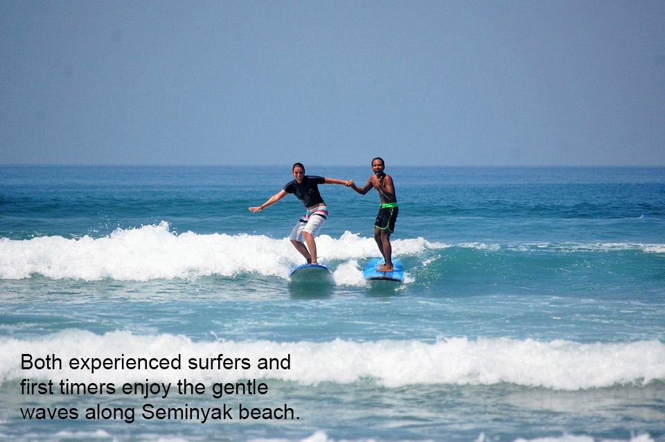Both experienced surfers and first timers enjoy the gentle waves along Seminyak Beach