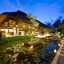 chalina-estate-living-room-and-lily-ponds-at-night